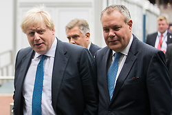 © Licensed to London News Pictures  . 03/10/2017 . Manchester , UK . BORIS JOHNSON and CONOR BURNS MP cross from the Midland Hotel to the Conference Centre , ahead of Boris' keynote speech , on day three of the Conservative Party Conference at the Manchester Central Convention Centre . Photo credit : Joel Goodman/LNP