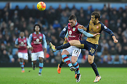 Jordan Veretout of Aston Villa challenges for the areal ball with Mathieu Flamini of Arsenal - Mandatory byline: Dougie Allward/JMP - 13/12/2015 - Football - Villa Park - Birmingham, England - Aston Villa v Arsenal - Barclays Premier League
