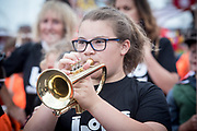 Children from Betteshanger Country Park and Deal Festival's Bold As Band march in and play in the Deal Regatta Parade.