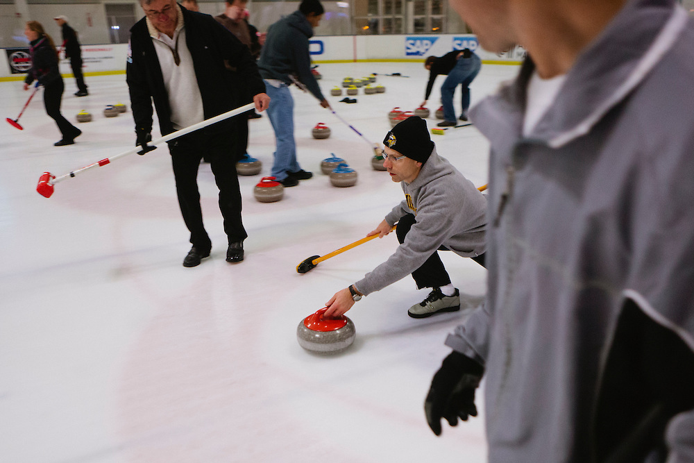 Brian Zaitz of San Jose delivers during the San Francisco Bay Area Curling Club's Tuesday night league at Sharks Ice in San Jose on Jan.15, 2013.
