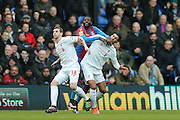 Crystal Palace forward Emmanuel Adebayor  battles with Liverpool defender Jon Flanagan (38)  and Liverpool midfielder Emre Can (23)  during the Barclays Premier League match between Crystal Palace and Liverpool at Selhurst Park, London, England on 6 March 2016. Photo by Simon Davies.