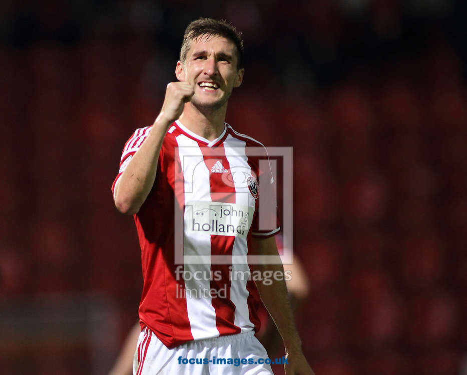 Chris Basham  of Sheffield United celebrates the 2-0 win over Bradford City during the Sky Bet League 1 match at the Coral Windows Stadium, Bradford<br /> Picture by Stephen Gaunt/Focus Images Ltd +447904 833202<br /> 18/10/2014