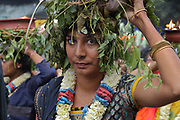 Woman carrying clay pots on their heads containing burning camphor oil, in the parade celebrating the festival of Ganesh Chaturthi, marking the birth of the Hindu god Ganesha, on the streets of the La Chapelle area of the 18th arrondissement of Paris, France, on Sunday 1st September 2019. The annual religious festivities and parade take place near the Ganesha Temple of Paris, or Sri Manicka Vinayakar Alayam Temple, the largest Hindu temple in France. Ganesha is the elephant-headed Hindu God of Beginnings, son of Shiva and Parvati, who represents love and knowledge. Picture by Manuel Cohen