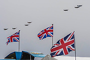 18 Spitfrires do a mass fly past as the finale - The Duxford Battle of Britain Air Show is a finale to the centenary of the Royal Air Force (RAF) with a celebration of 100 years of RAF history and a vision of its innovative future capability.