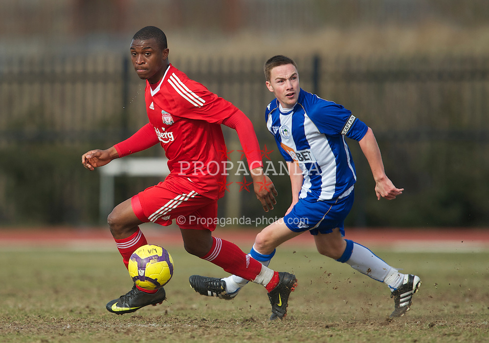 WIGAN, ENGLAND - Wednesday, March 17, 2010: Liverpool Reserves' David Amoo and Wigan Athletic Reserves' Jon Routledge during the Lancashire Senior Cup Semi-Final at the Robin Park Sports Arena. (Photo by David Rawcliffe/Propaganda)