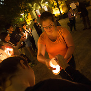 An interfaith vigil is held in support of violence in the Middle-East at Boston University on September 29, 2014 in Boston, Massachusetts. (Photo by Elan Kawesch)