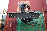 Carlos Lee Sullivan works on his mural in the evening of August 5, 2017 during the Freak Alley Gallery seventh annual mural event in downtown Boise, Idaho.<br /> <br /> Carlo's mural was based on one of his abstract triptychs.  While painting, he was thinking of architecture, arches and columns. But he didn't was to reference these too directly, so he was deconstructing at the same time - allowing him to rough in the shapes. <br /> <br /> Freak Alley Gallery's week long event provided an &quot;art-in-motion&quot; experience as it welcomed the public to watch artists work on their murals.