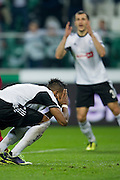 Legia's Dossa Junior reacts after his missed shoot during the UEFA Europa League Group J football match between Legia Warsaw and Trabzonspor AS at Pepsi Arena Stadium in Warsaw on November 07, 2013.<br /> <br /> Poland, Warsaw, November 07, 2013<br /> <br /> Picture also available in RAW (NEF) or TIFF format on special request.<br /> <br /> For editorial use only. Any commercial or promotional use requires permission.<br /> <br /> Mandatory credit:<br /> Photo by &copy; Adam Nurkiewicz / Mediasport