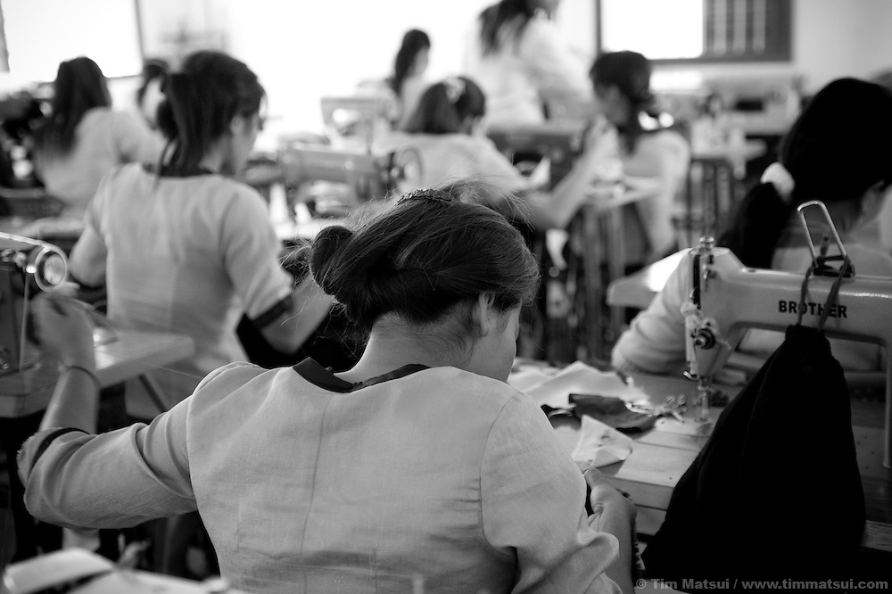 "Young women at Tom Dy, a residential facility run by the non governmental organization ""Acting for Women in Distressing Situations"" (AFESIP) on the outskirts of Phnom Penh, Cambodia, learn to sew as part of the job re-training program of AFESIP. Tom Dy offers housing, education, training, and counseling. Founded by Somaly Mam, who herself was once a prostitute and victim of trafficking and domestic abuse, AFESIP has three facilities in Cambodia and works with other NGO's to provide long term care for the women."