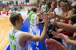 Miha Lapornik of Slovenia  celebrates after the basketball match between National teams of Slovenia and Spain in Qualifying Round of U20 Men European Championship Slovenia 2012, on July 18, 2012 in Domzale, Slovenia. Slovenia defeated Spain 70-63. (Photo by Vid Ponikvar / Sportida.com)