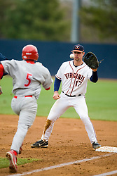 Virginia Cavaliers INF Jeremy Farrell (17) makes an out at first base, beating Radford Highlanders catcher Nachion Moore (5) to the bag.  The #16 ranked Virginia Cavaliers baseball team defeated the Radford Highlanders 8-2 at the University of Virginia's Davenport Field in Charlottesville, VA on March 11, 2008.