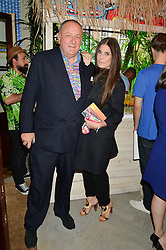 JEAN PIGOZZI and ELIZABETH SALTZMAN at the launch of the new collection from Limoland held at Anderson & Sheppard's Haberdashery, 17 Clifford Street,London on 16th June 2014.