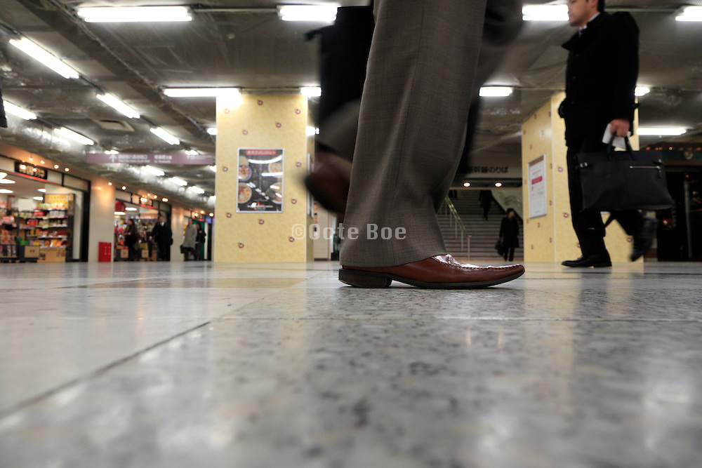 businessmen walking in corridor Japan Tokyo