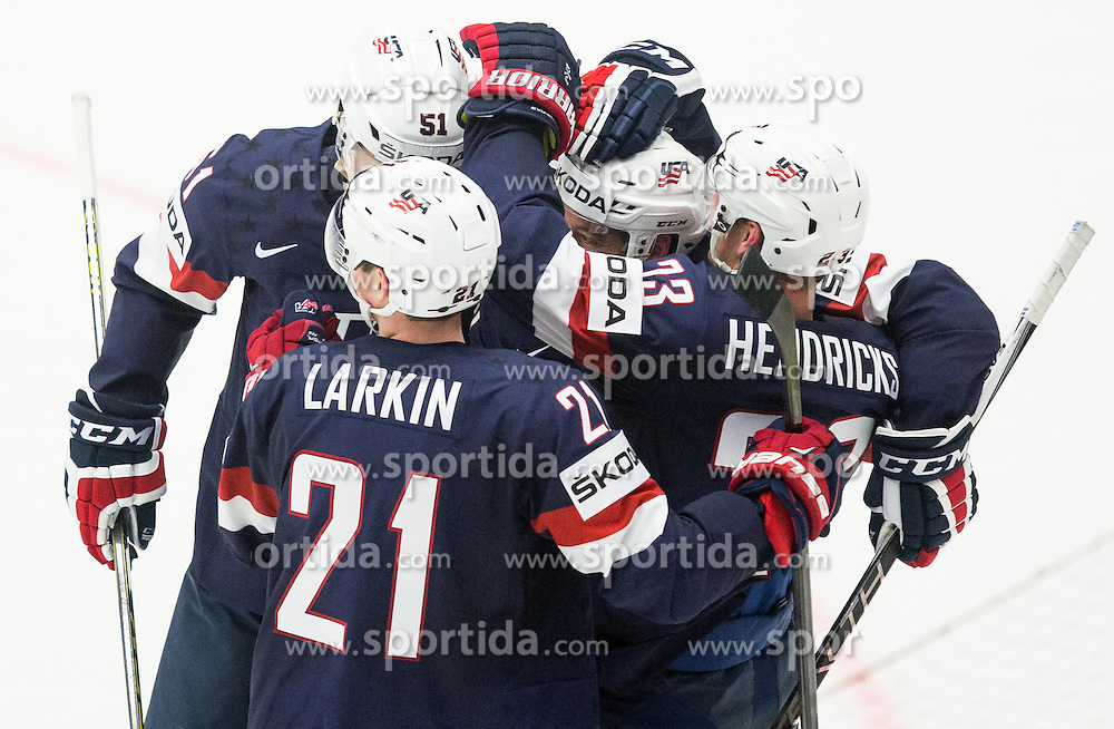 Players of USA celebrate after scoring second goal for USA  vs Pekka Rinne of Finland and Jyrki Jokipakka of Finland during Ice Hockey match between USA and Finland at Day 1 in Group B of 2015 IIHF World Championship, on May 1, 2015 in CEZ Arena, Ostrava, Czech Republic. Photo by Vid Ponikvar / Sportida