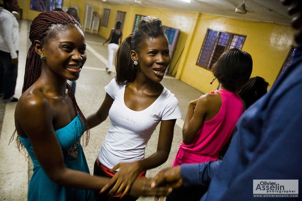 Nana Yaa Adadewa Addo (left), 24, jokes with friends during a rehearsal in Ghana's capital Accra on Thursday May 21, 2009. Nana Yaa is one of several Ghanaian girls who auditioned for the upcoming television show West Africa's Next Top Model, the latest incarnation of Tyra Banks' America's Next Top Model.
