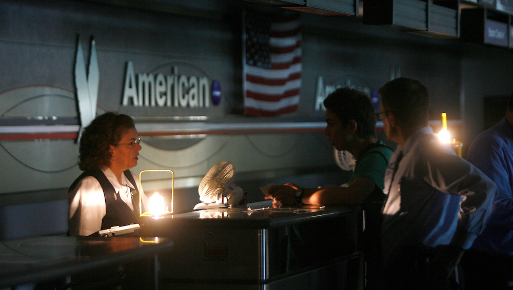Ticket agents help stranded passengers at LaGuardia Airport after high heats caused a power outage that cancelled American Airlines flights in, New York, Tuesday 18 July 2006 ..