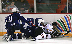 Andrej Tavzelj of Slovenia and Raitis Ivanans (41) at ice-hockey match Slovenia vs Latvia at Preliminary Round (group B) of IIHF WC 2008 in Halifax, on May 06, 2008 in Metro Center, Halifax, Nova Scotia, Canada. Latvia won 3:0. (Photo by Vid Ponikvar / Sportal Images)Slovenia played in old replika jerseys from the year 1966, when Yugoslavia hosted the World Championship in Ljubljana.