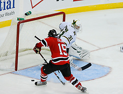 Oct 22, 2008; Newark, NJ, USA; New Jersey Devils center Travis Zajac (19) shoots the puck wide of Dallas Stars goalie Tobias Stephan (31) during the third period at the Prudential Center. The Devils defeated the Stars 5-0.