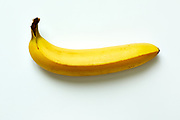 Close up of a ripe banana isolated on white background.