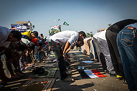 Morsi and Muslim Brotherhood supporters paused their lively demonstration for prayers.