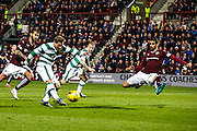 Celtic FC Midfielder Kris Commons smashes a shot during the Scottish League Cup presented by Ulilita Energy quarter final match between Heart of Midlothian and Celtic at Tynecastle Stadium, Gorgie, Scotland on 28 October 2015. Photo by Craig McAllister.