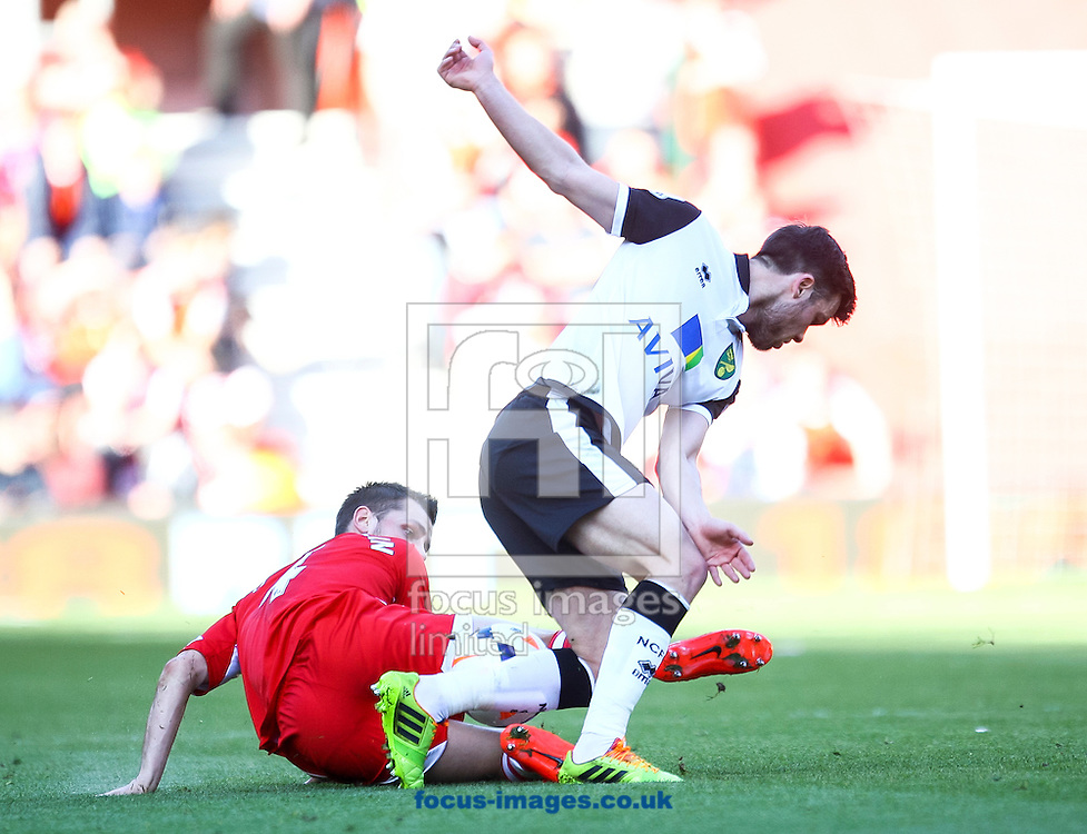 Morgan Schneiderlin of Southampton tackles Jonathan Howson of Norwich City during the Barclays Premier League match at the St Mary's Stadium, Southampton<br /> Picture by Daniel Chesterton/Focus Images Ltd +44 7966 018899<br /> 15/03/2014