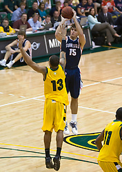 January 30, 2010; San Francisco, CA, USA;  Gonzaga Bulldogs guard Matt Bouldin (15) shoots over San Francisco Dons guard Rashad Green (13) during the first half at the War Memorial Gym.  San Francisco defeated Gonzaga 81-77 in overtime.