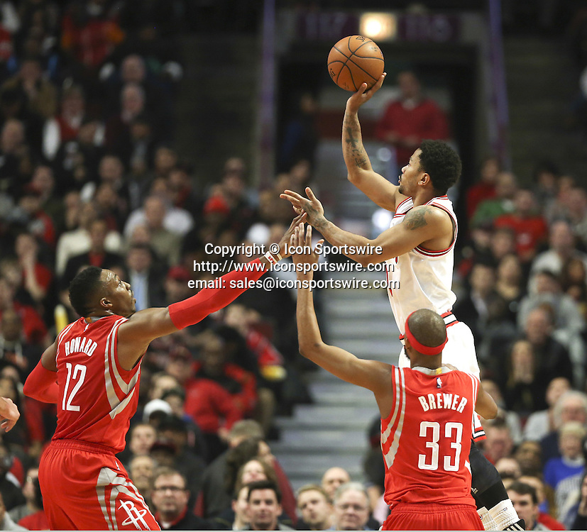 Jan. 5, 2015 - Chicago, IL, USA - Chicago Bulls guard Derrick Rose (1) makes a basket as he is double teamed by Houston Rockets center Dwight Howard (12) and Houston Rockets guard Corey Brewer (33) during the second half on Monday, Jan. 5, 2015, at the United Center in Chicago