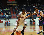 """Ole Miss' Jarvis Summers (32) vs. SMU's London Giles (11) at the C.M. """"Tad"""" Smith Coliseum in Oxford, Miss. on Tuesday, January 3, 2012. Ole Miss won 50-48."""
