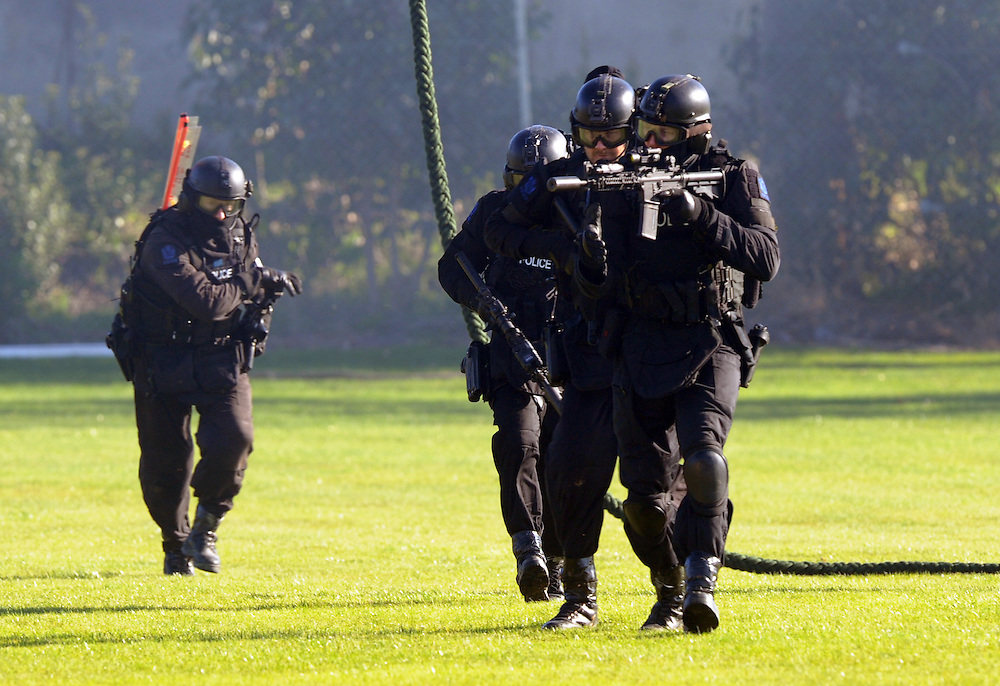 Police Special Tactics Group take part in an public display as part of the 50 year celebration of the AOS (Armed Offenders Squad) at the Royal Police College, Porirua, New Zealand, Saturday, August 09, 2014. Credit:SNPA / Ross Setford