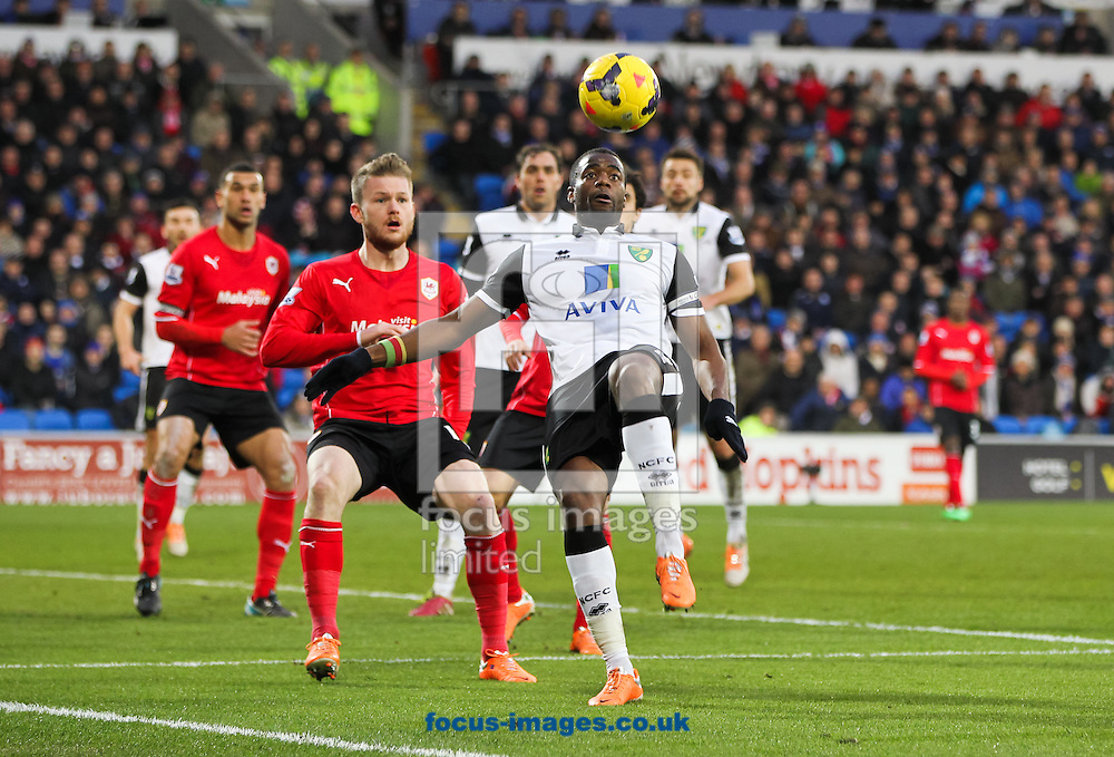 Picture by Tom Smith/Focus Images Ltd 07545141164<br /> 01/02/2014<br /> S&eacute;bastien Bassong (centre right) of Norwich City watches the ball come down during the Barclays Premier League match at the Cardiff City Stadium, Cardiff.