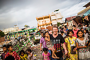 "Scott Neeson, Scottish-Australian film executive turned philanthropist, and Executive Director of the Cambodian Children's Fund engaging with the local community in an impoverished neighbourhood of Phnom Penh - Phnom Penh, Cambodia, May 29th 2015. CREDIT: Christian Berg for The Wall Street Journal - ""Weekend Confidential - Scott Neeson"""