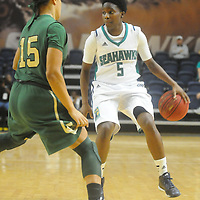UNCW's Shatia Cole drives on William and Mary's Jazmen Boone Sunday January 4, 2015 at Trask Coliseum on the campus of UNCW. (Jason A. Frizzelle)