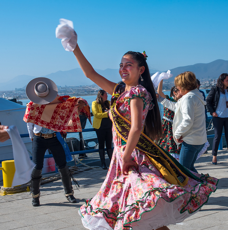 Coquimbo, Chile--April 7, 2018. Dancers in native dress great cruise vessel passengers as they disembark the ship in the port city of Coquimbo, Chile. Editorial Use Only.
