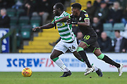 Yeovil Towns Olufela Olomola(24) and Forest Green Rovers Reece Brown(10) battle for the ball during the EFL Sky Bet League 2 match between Yeovil Town and Forest Green Rovers at Huish Park, Yeovil, England on 8 December 2018.
