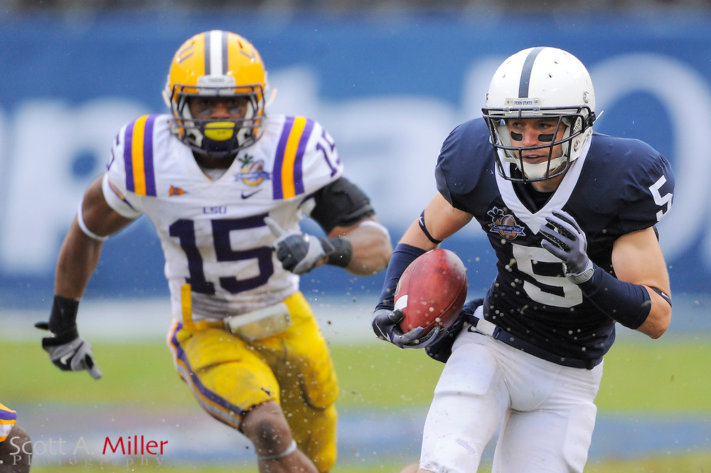 Jan. 1, 2010; Orlando, FL, USA; Penn State Nittany Lions wide receiver Graham Zug (5) runs up field as he is chased by LSU Tigers cornerback Brandon Taylor (15) during the first half of the 2009 Capital One Bowl at the Citrus Bowl. ©2010 Scott A. Miller