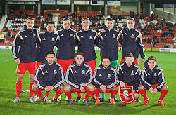 WREXHAM, WALES - Tuesday, November 17, 2015: Wales players line up for a team group photograph before the UEFA Under-21 Championship Qualifying Group 5 match against Romania at the Racecourse Ground. Back row L-R: Thomas Lockyer, Thomas O'Sullivan, Lee Evans, Joshua Yorwerth, goalkeeper Billy O'Brien, Ryan Hedges. Front row L-R: Liam Shephard, Wesley Burns, Joshua Sheehan, captain Declan John, Harry Wilson. (Pic by David Rawcliffe/Propaganda)