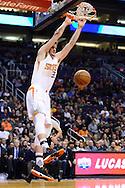 Jan 3, 2017; Phoenix, AZ, USA;  Phoenix Suns forward Dragan Bender (35) dunks the basketball in the first half of the NBA game against the Miami Heat at Talking Stick Resort Arena. The Suns won 99-90. Mandatory Credit: Jennifer Stewart-USA TODAY Sports