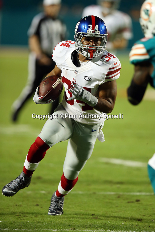 New York Giants running back Shane Vereen (34) runs for a first down and goal to go at the Miami Dolphins 5 yard line with less than one minute left in the second quarter during the NFL week 14 regular season football game against the Miami Dolphins on Monday, Dec. 14, 2015 in Miami Gardens, Fla. The Giants won the game 31-24. (©Paul Anthony Spinelli)