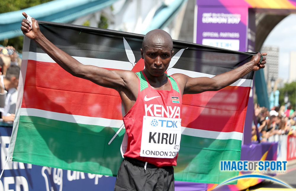 Geoffrey Kirui (KEN) poses with Kenyan flag after winning the marathon in 2:08:27 in the IAAF World Championships in Athletics in London on Sunday, August 6, 20017. (Jiro Mochizuki/Image of Sport)