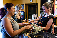Attendees inspect merchandise at the screening of Blood Road at the Bluebird Theater in Denver, CO, USA on 27 June, 2017.