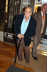 Actor WARREN MITCHELL at a party to celebrate the publication of an autobiography by the late Jack Rosenthal at The Fine Art Society, 148 New Bond Street, London W1 on 21st April 2005.<br />