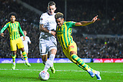 Leeds United defender Ben White (5) tackles West Bromwich Albion forward Grady Diangana (29) during the EFL Sky Bet Championship match between Leeds United and West Bromwich Albion at Elland Road, Leeds, England on 1 October 2019.