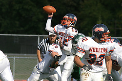 22 October 2005: Thunder QB Jeremy Chupp lets go a pass as he gets hit from the blind side by the Titan defense. The Illinois Wesleyan Titans posted a 23 - 14 home win by squeeking past the Thunder of Wheaton College at Wilder Field (the 5th oldest collegiate field in the US) on the campus of Illinois Wesleyan University in Bloomington IL