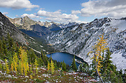 Lake Ann and golden larches after autumn snowfall. North Cascades Washington
