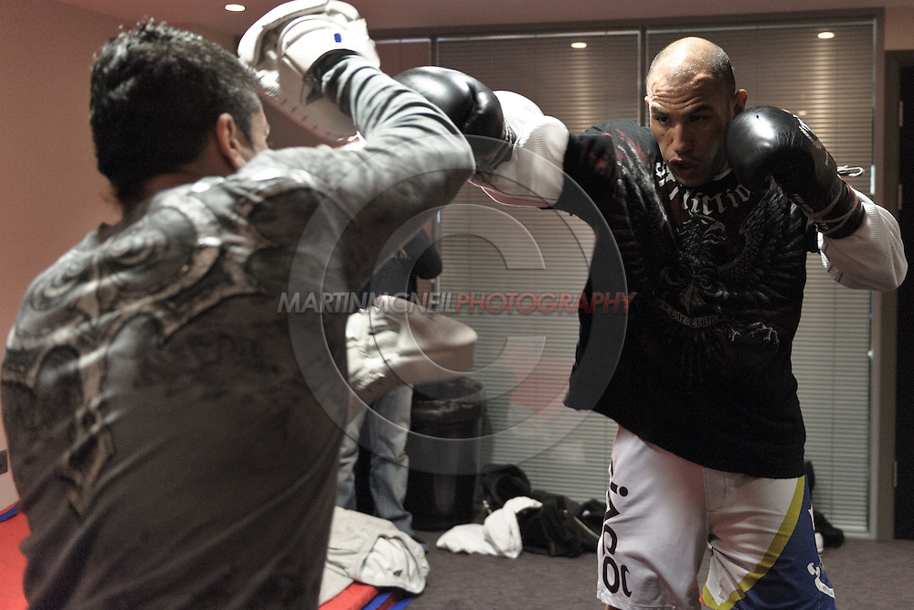 MANCHESTER, ENGLAND, NOVEMBER 11, 2009: Brandon Vera (right) performs focus mitt striking drills during the open work-outs for UFC 105 at the Crowne Plaza Hotel in Manchester, England on November 11, 2009.