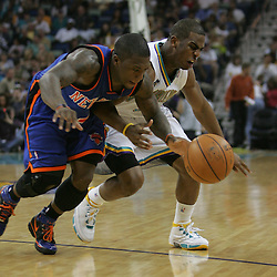 Chris Paul #3 of the New Orleans Hornets fights for a loose ball with New York Knicks guard Jamal Crawford #11 in the third quarter of their NBA game on April 4, 2008 at the New Orleans Arena in New Orleans, Louisiana. New Orleans Hornets defeated the New York Knicks 118-110 and with the win clinched a NBA Playoff birth.
