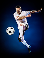 one caucasian soccer player man isolated on black background