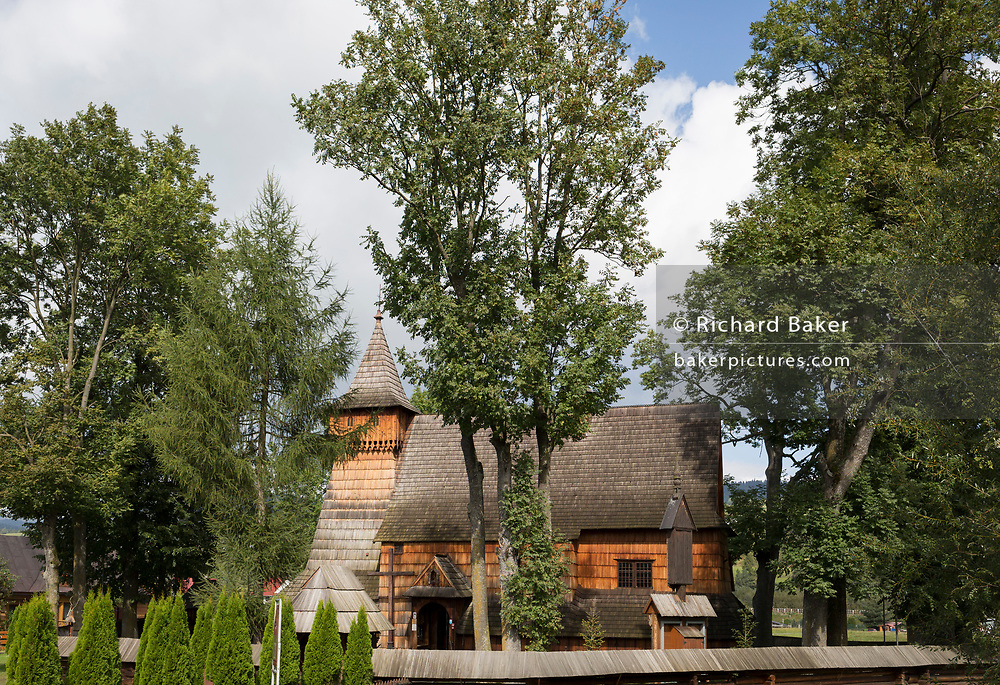 An exterior of the Parish Church of St. Michael the Archangel, Debno Podhalanskie, Malopolska, Poland. The church is one of the most highly regarded examples of wooden Gothic architecture in Europe. The ceilings and walls are covered with geometric, figural and floral motifs painted in around 1500.