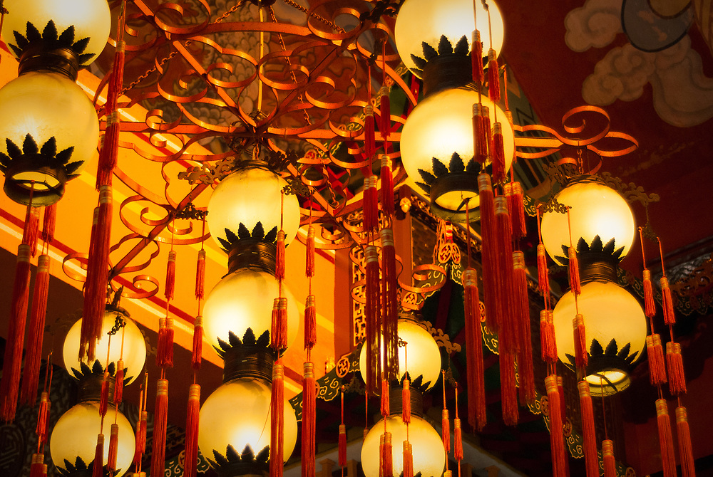Lanterns hanging from ceiling of main hall in Po Lin Monastery